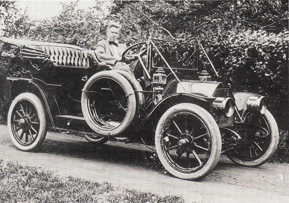 Black and white photo of early Ford model car